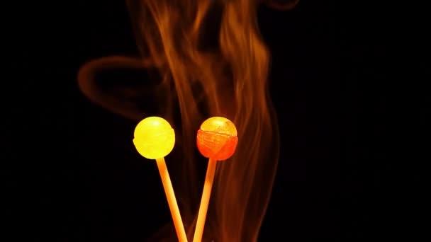 Two lollipop smoke dark background nobody hd footage