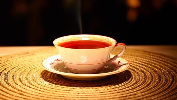 one hot tea cup spoon gold bokeh nobody hd footage