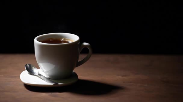 one hot coffee cup spoon wooden table dark background nobody hd footage