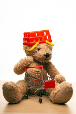 image of toy bear basket trolley white background