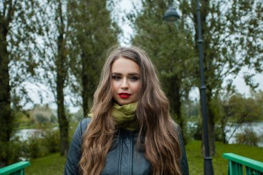 Pretty woman in park outdoor on green nature background