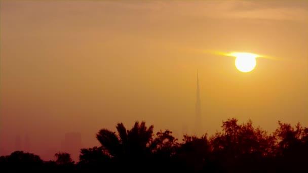 Timelapse of Sun Setting Behind Skyscraper.