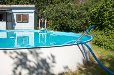 Swimming pool at their summer cottage