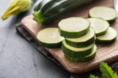 Fresh zucchini on wooden table close up. Copy space.