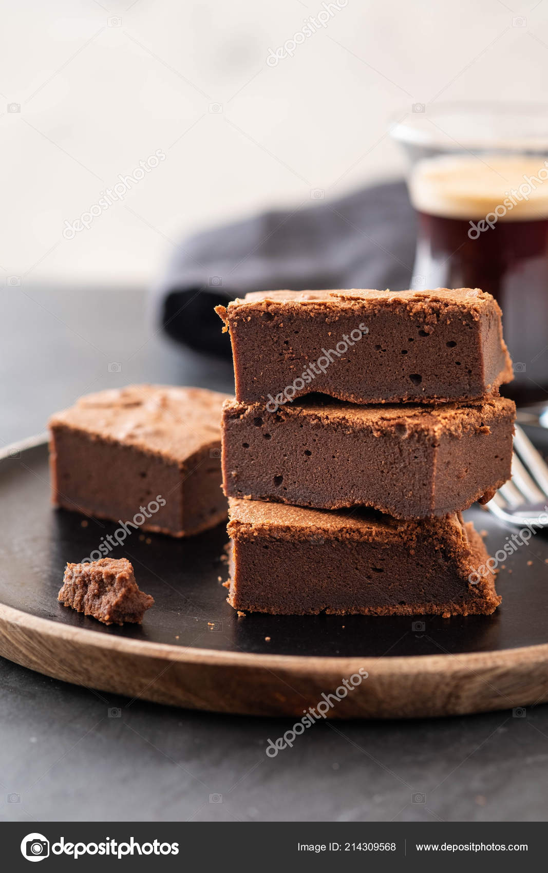 Double Chocolate Brownies. Homemade chocolate fudge brownies with chocolate chips and black background. Copy space.– stock image