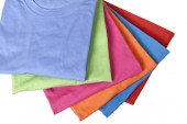 Fotografie Stack of colorful t-shirts folded neatly isolated over white background