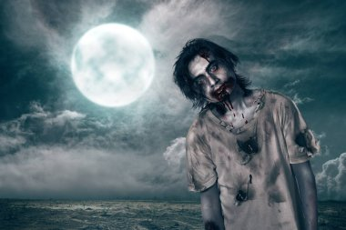 Creepy zombie man with blood on his mouth over moonlight background