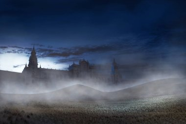 Old building with scary mist on the night. Halloween background