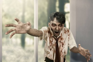 Scary zombie man haunted a house. Halloween concept