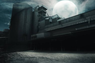 Abandoned old factory at night. Halloween background