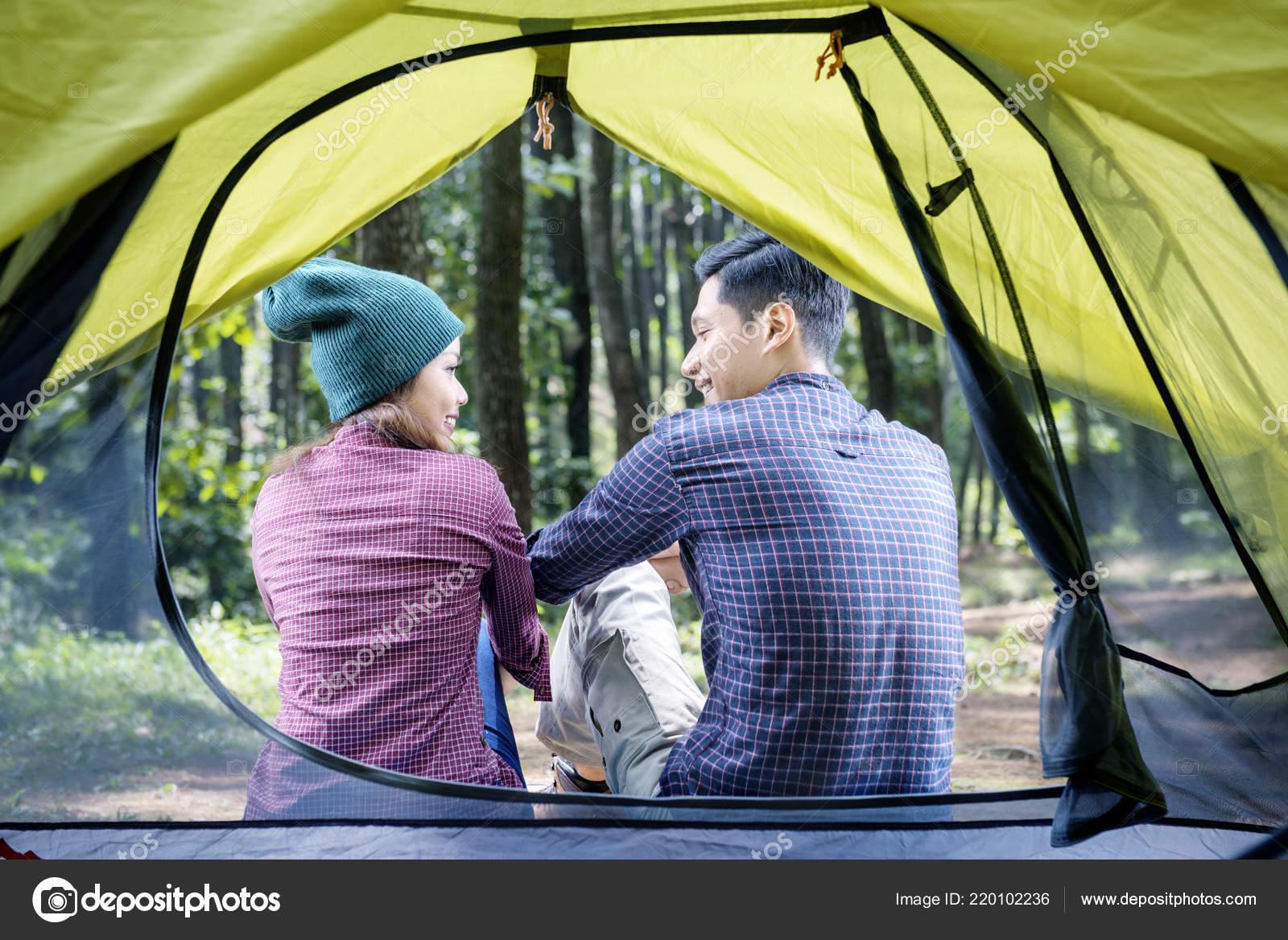 Rear View Asian Couple Relaxing Tent View u2014 Stock Photo & Rear View Asian Couple Relaxing Tent View u2014 Stock Photo © leolintang ...