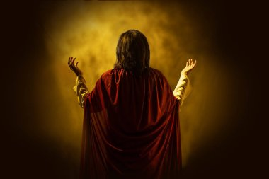 Rear view of Jesus christ praying to god with yellow bright background