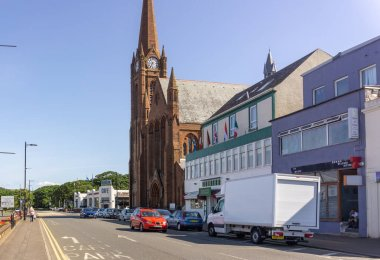 Largs, Scotland, UK - July 19, 2018: Looking along Gallowgate St in Largs towards 'Nardini's' famous Art Deco cafe on a record breaking hot summers day.