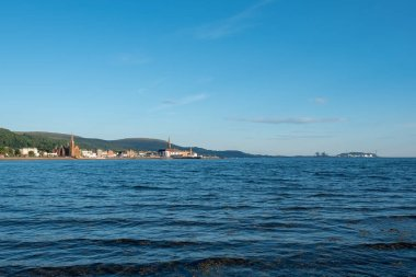 Largs in Scotland during unusualy hot weather with clear skys above the hillside over the town.