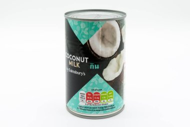 Irvine, Scotland, UK - March 08, 2020: Sainsburys Branded Coconut Milk in recyclable tin can, and lid. Label displays Kcal and energy values.
