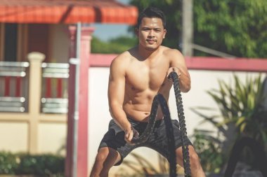 Man with rope at fitness