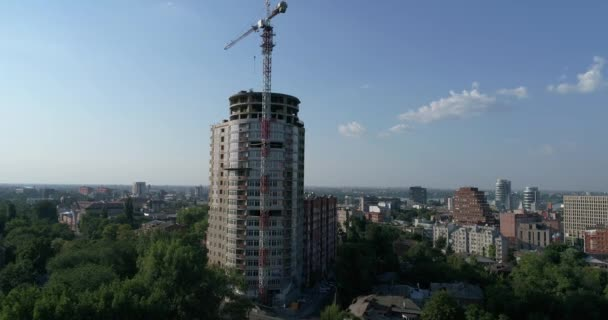 Construction of a multi-storey building, Tower crane, Unfinished multi-storey building, Building a high rise