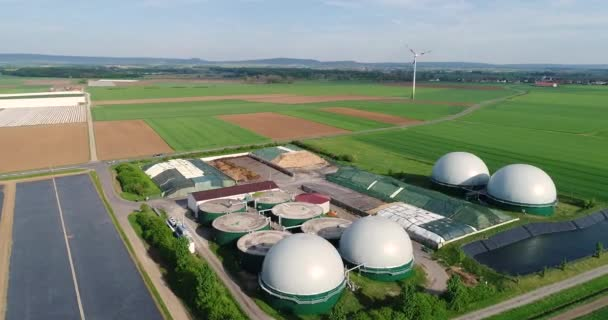 Wind turbine and biogas plant in green field, alternative energy sources,  renewable energy