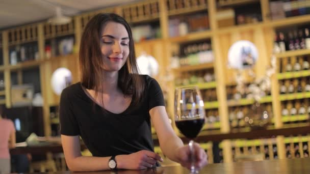 Woman having a glass of red wine, A girl with a glass of red wine, a young beautiful girl is drinking red wine in a restaurant