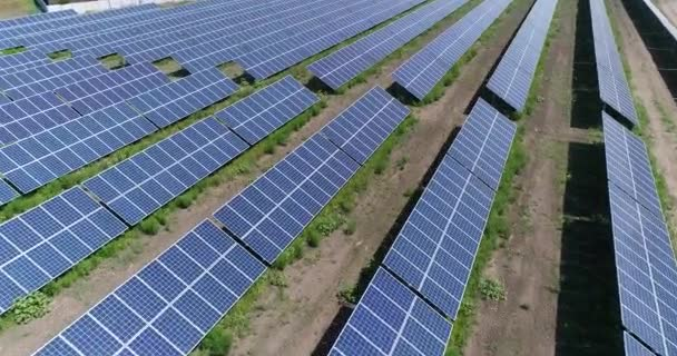 Aerial view to solar power plant. Industrial background on renewable resources theme. flying over rows of solar panels, solar panels, solar panels on the field