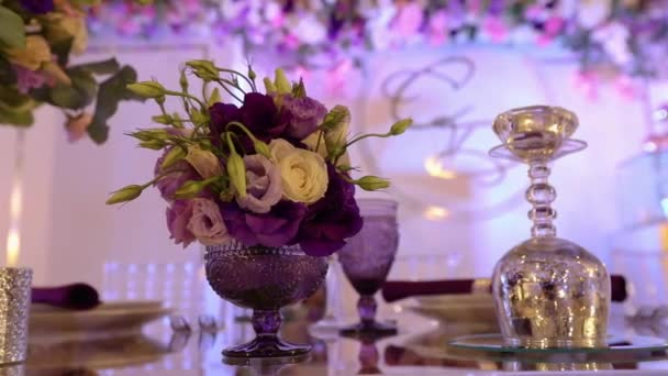 Beautiful bouquet in the wedding decor, purple flowers at the wedding