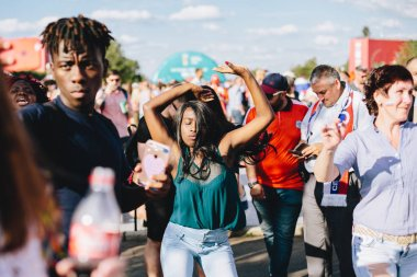 MOSCOW, RUSSIA - JUNE 2018 An African-American girl dances in a fan zone during the World Cup