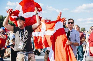 MOSCOW, RUSSIA - JUNE 2018 Danish fans with a national flag in the fan zone during the World Cup