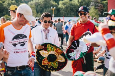 MOSCOW, RUSSIA - JUNE 2018 Mexican fans with national headdress sombrero in the fan zone during the World Cup