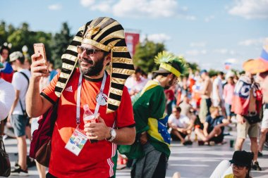 MOSCOW, RUSSIA - JUNE 2018 A football fan in the headdress of the Egyptian pharaoh in the fan zone during the World Cup