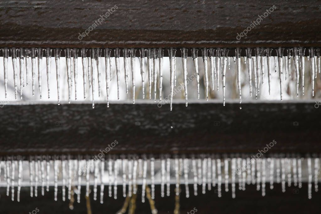 Hanging icicles after a freezing rain weather phenomenon