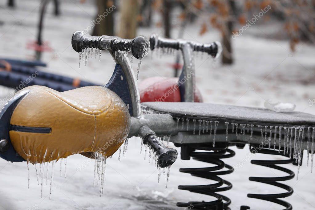 Frozen children playground after a freezing rain weather phenomenon