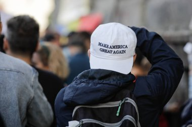 Bucharest, Romania - October 10, 2020: Man wears Make America Great Again cap during a political rally.