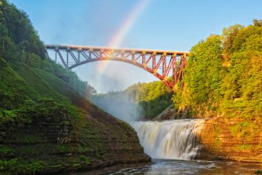 Rainbow Over The Railroad Arch And Upper Falls At Letchworth State Park In New York