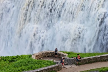 CASTILE, NY - MAY 24, 2018: Tourists enjoying the view at the Middle Falls in Letchworth State Park New York.