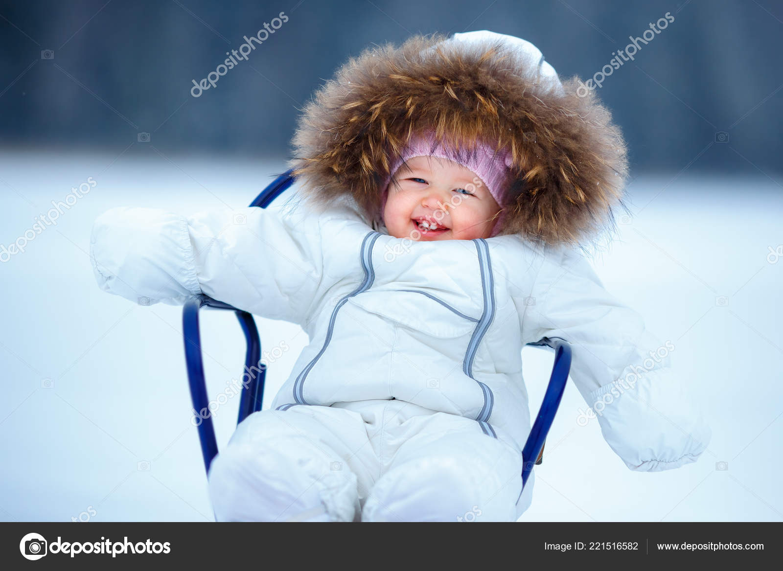 10872c4cb732 Sled and snow fun for kids. Baby sledding in snowy winter park ...