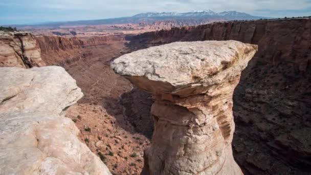 Time lapse moving up viewing rock spire off cliff in Long Canyon near Moab Utah.