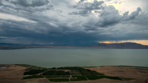 Time lapse of dark storm clouds building over Utah Lake in the evening.