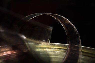 Old film with a movie on a dark background. Film lies on movie cracker