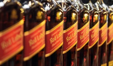 Volzhsky, Russia - apr 26, 2019: Products of hypermarket sale of alcoholic Johnnie Walker is a brand of Scotch whisky owned sale of alcoholic beverages in the metro store cash and carry