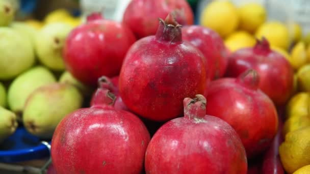 Pomegranate fruits close-up kept for sale in the street of market. selective focus