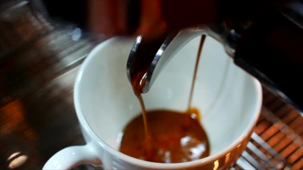 5 in 1. Coffee espresso preparation, espresso coffee of the highest quality Italian made with a professional coffee machine falls into a coffee cup. stock footage