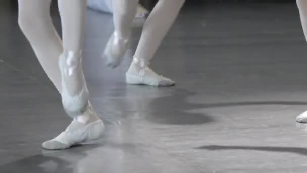 Ballet. Close-up of a girls legs in white ballet shoes during ballet training. Element of classical dance. 4K.