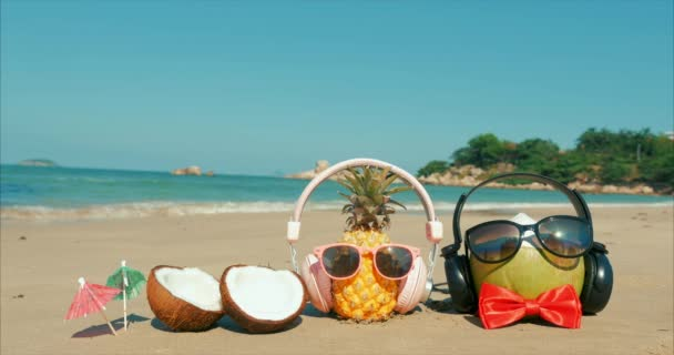 On a Tropical Beach Close-Up of Fruit in Sunglasses Under the Hot Summer Sun Along the Tropical Exotic Coast, Pineapple and Coconut in Sunglasses on the Ocean Background.Concept Summer, Party, Holiday
