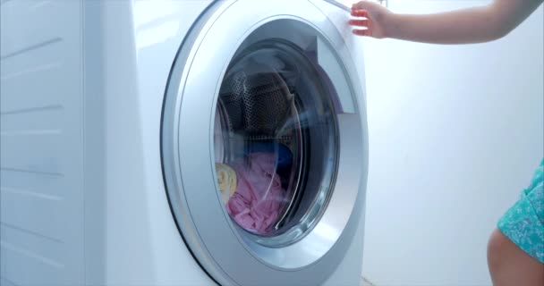 Close Up Industrial Washing Machine Washes Colored Clothing and White Linen, White Striped Clothing. Cylinder Spinning Machine. Concept Laundry Washing Machine, Industry Laundry Service.