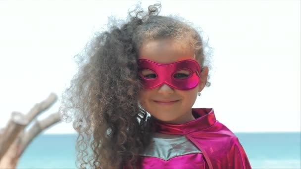 Beautiful Llittle Girl in the Superhero Costume, Close Up Portrait Child in the Mask of the Hero.