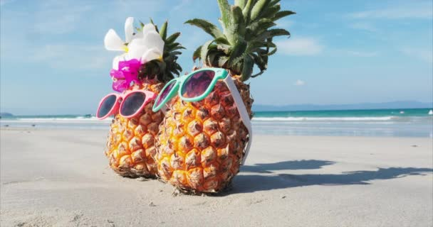 On a Tropical Beach Close-Up of Under the Hot Summer Sun Along the Tropical Exotic Coast standing on sand tropical fruits. Concept Summer Background.