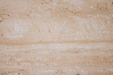 Texture of natural beige limestone. Copy space stone background.