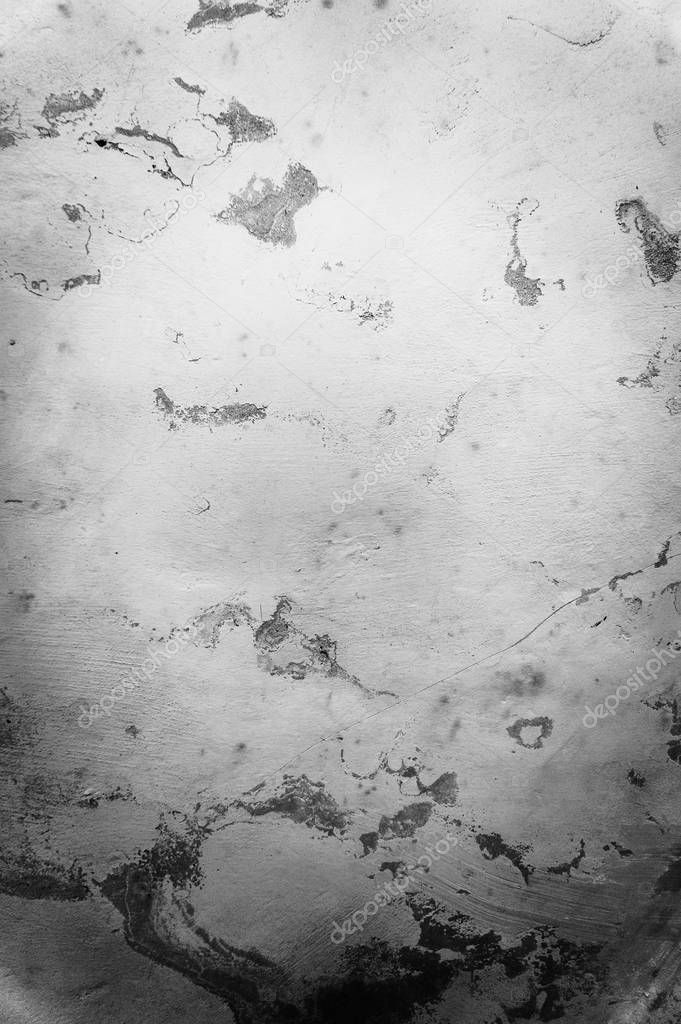 Old cracked stone wall background for design. Grunge monochrome classic texture.