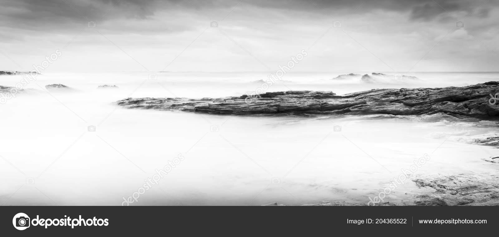Calm Ocean Landscape Time Lapse Smooth Waves Rocks Black