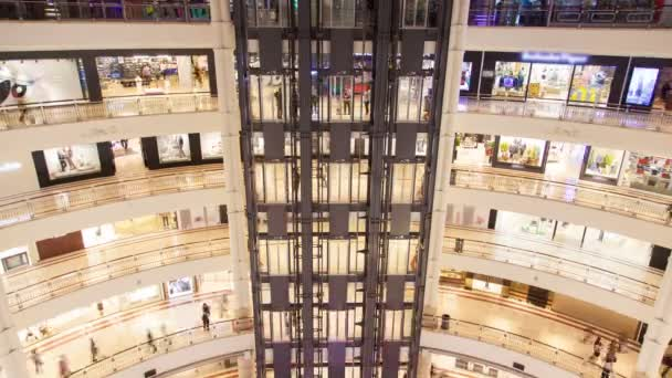Shopping mall multi-storey hall with moving elevators time lapse